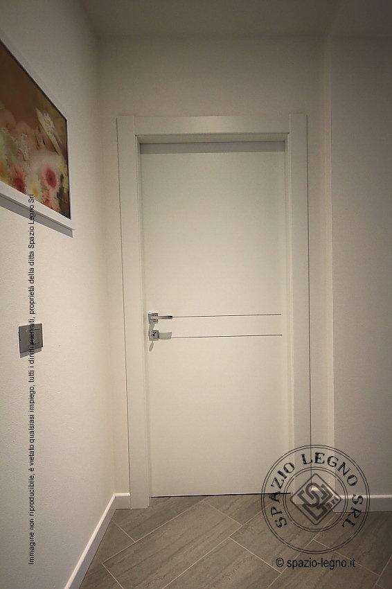 Porte scorrevoli tuttovetro e porte bianche melaminico for Porte interne bianche moderne